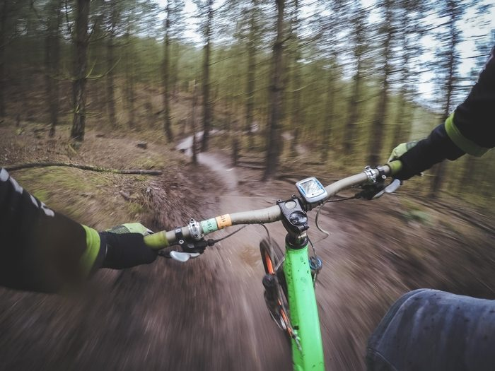 Person mountain biking an activity which can be tracked with an Apple Watch