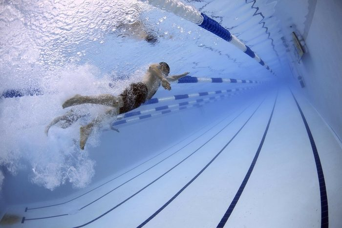 Person swimming in swimming pool an activity that can be tracked with an Apple Watch