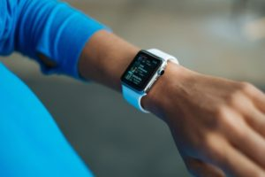 Smart watch being worn on wrist